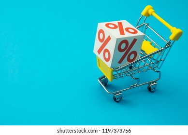 Shopping in department store, modern trade, hypermarket in lifestyle sale promotion season concept. Percentage(%) paper box in supermarket trolley on blue background. Shopaholic love 50% off promotion