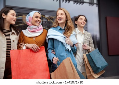 Shopping. Diversity Women Bonding Bags. Smiling Multicultural Girls Walking Near Mall. Different Ethnicity Friendship And Urban Lifestyle.