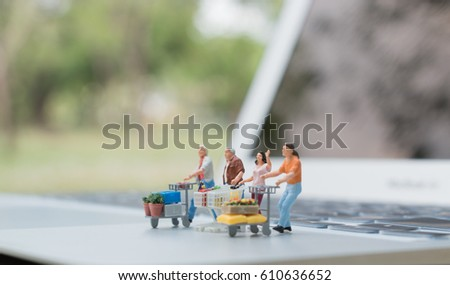 Shopping And E Commerce Concept. Miniature People : Group Of Miniatures  With Shopping Cart