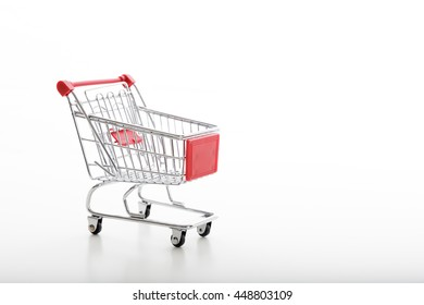 Shopping. Empty supermarket trolley isolated on white background