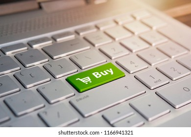 shopping enter button key on white keyboard. Color button on the gray silver keyboard of modern ultrabook. caption on the button
