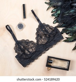 Shopping and fashion concept. Set of glamorous stylish sexy lace lingerie with cosmetic products, woman accessories on wooden background. Top view point