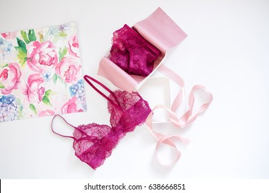 Shopping and fashion, female wardrobe concept. Set of glamorous stylish sexy lace lingerie in pink giftbox on white background. Woman accessories.