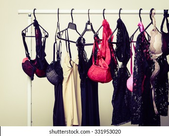 Shopping and fashion. Hanger with seductive sexy colorful lingerie underclothes. Shop interior.