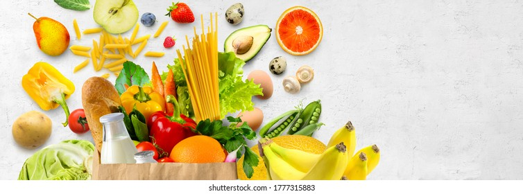 Shopping food in supermarket. Different fruits and vegetables on white textured wall background. Copy space. Healthy food background. - Shutterstock ID 1777315883