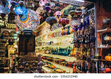 Shopping at the Grand Bazaar. Traditional Turkish lamps in the souvenir shop. Handmade glass mosaic at the Grand Bazaar. Nazar Bonjuk against the evil eye