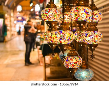 Shopping in the Grand Bazar. Traditional Turkish lamps in souvenir shop. Handmade mosaic of colored glass in Grand Bazaar.
