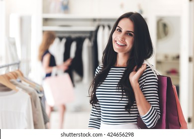 9fda75a2b Shopping is her passion. Portrait of beautiful young woman with shopping  bags looking at camera
