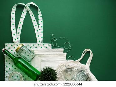 shopping kit for zero waste lifestyle on green background