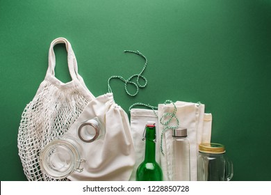 shopping kit for zero waste lifestyle on green background