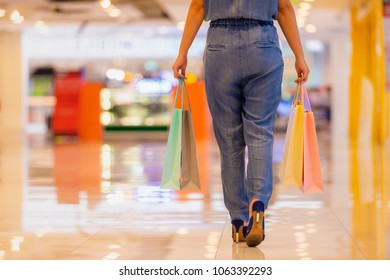 Shopping, Lifestyle Concept - Cropped shot of shopper woman holding the shopping bags at shopping mall.