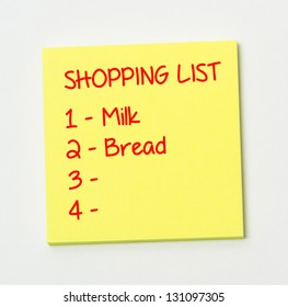Shopping list on yellow paper note