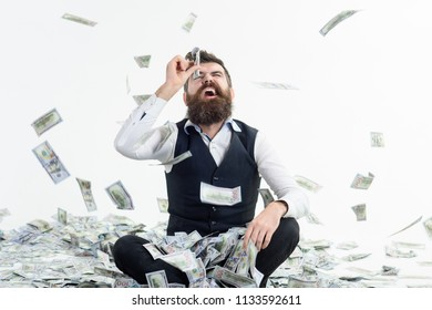 Shopping lottery. Income. Benefit. Earnings. People concept. Portrait of glad satisfied bearded millionaire. Easy-money. Bearded man excited with money. Man looking through banknote.