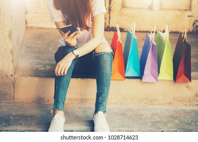 shopping mall. Happy woman holding shopping many color bag enjoying in shopping. Consumerism, shopping, lifestyle concept