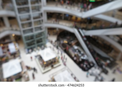 Shopping mall modern interior design with people in blur background