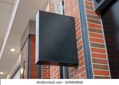 Shopping mall store signage mockup. Rectangular vertical shape, black color