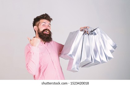 Shopping on black friday. Happy shopping with bunch paper bags. Profitable deal. Shopping addicted consumer. Total sale concept. Man bearded hipster with lot shopping bags. Could not resist discount.