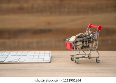 shopping online concept small red trolley on the table