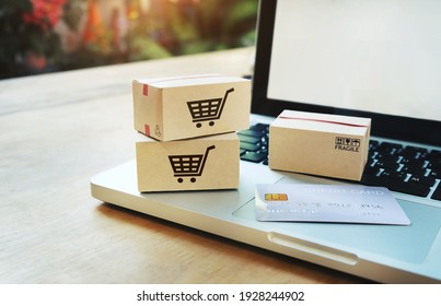 Shopping online concept,Paper boxes on a laptop and credit card Consumers can shop from home service.