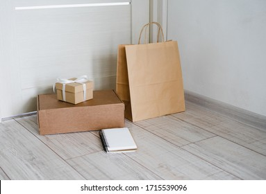 Shopping online. Delivery to the door. Contactless delivery of goods. Buy sitting at home. Stay home.