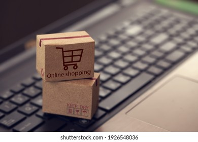 Shopping online, e-commerce concept: Cardboard boxes on keyboard. depicts of transportation that can be done easily using an online internet.