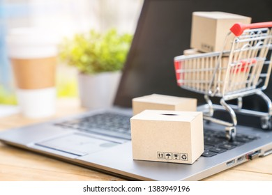 Shopping online and electronic commerce concept, Boxes and supermarket cart on computer laptop