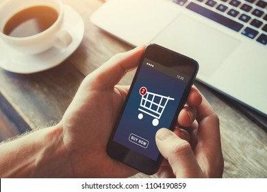 shopping online on internet store, order and buy things via mobile smartphone app on the screen, checkout interface in virtual shop