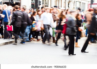 shopping people crossing the street in London City