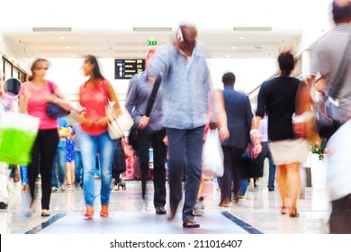 shopping people in motion blur