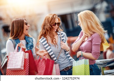 Shopping, people,sale and tourism concept ; girls with shopping bags in city.