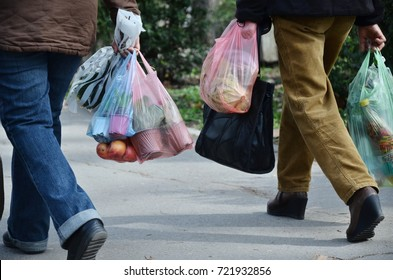 shopping with plastic bags, need to think about recycling