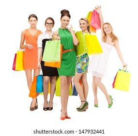 shopping, presents and gifts - attractive girls holding color shopping bags