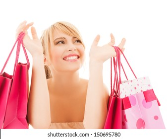 shopping and sales concept - happy woman with many shopping bags