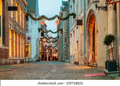 Shopping street with christmas lights in the city center of Maastricht, The Netherlands