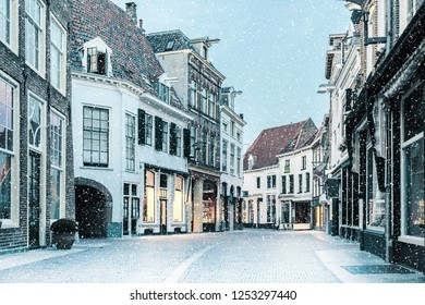 Shopping street with snowfall in the Dutch city center of Zutphen, The Netherlands