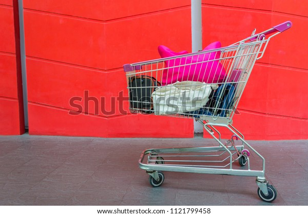 Shopping Supermarket trolley cart with the orange wall