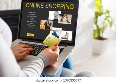 shopping, technology and internet concept: young girl shopping with laptop computer on a fictional shop