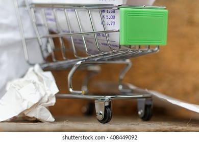 Shopping till receipt and cart concept for grocery expenses and consumerism