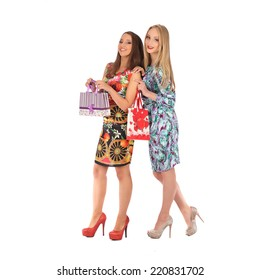 shopping and tourism concept - beautiful girls with bags, studio