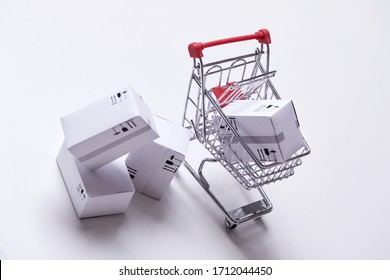 shopping trolley with boxes on white