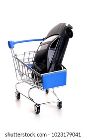 Shopping trolley with car on white background