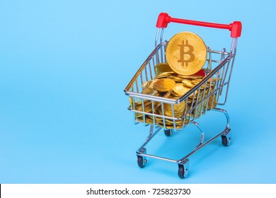 Shopping trolley cart with Coins bitcoin, buying goods for crypto currency. Empty space for text