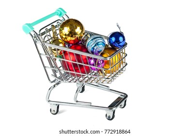Shopping trolley with Christmas decorations. Concept: preparation for the Christmas holiday.
