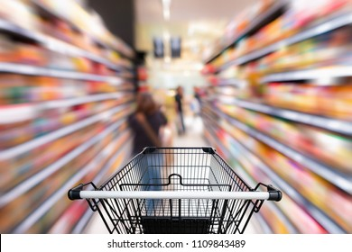 Shopping trolley in department store with goods shelf background.