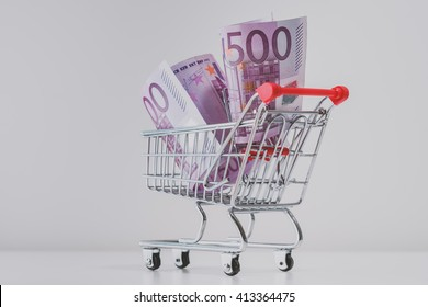 Shopping trolley full of euros, isolated on white background