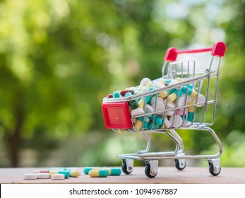 shopping trolley full of medicine with pills and capsules on bokeh background. Healthy and medical concept.