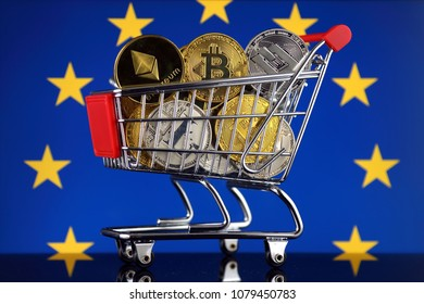 Shopping Trolley full of physical version of Cryptocurrencies (Bitcoin, Litecoin, Dash, Ethereum) and European Union Flag.