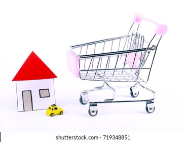 Shopping trolley and  house over white background