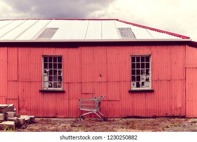 Shopping trolley at red shed