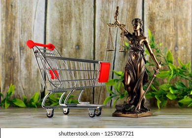 Shopping trolley and symbol of law and justice. Consumer rights concept. Regulations, restrictions, prohibition.